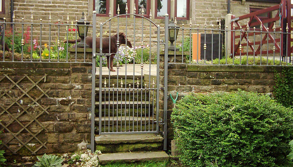 Wrought Iron Garden Gate with matching fencing