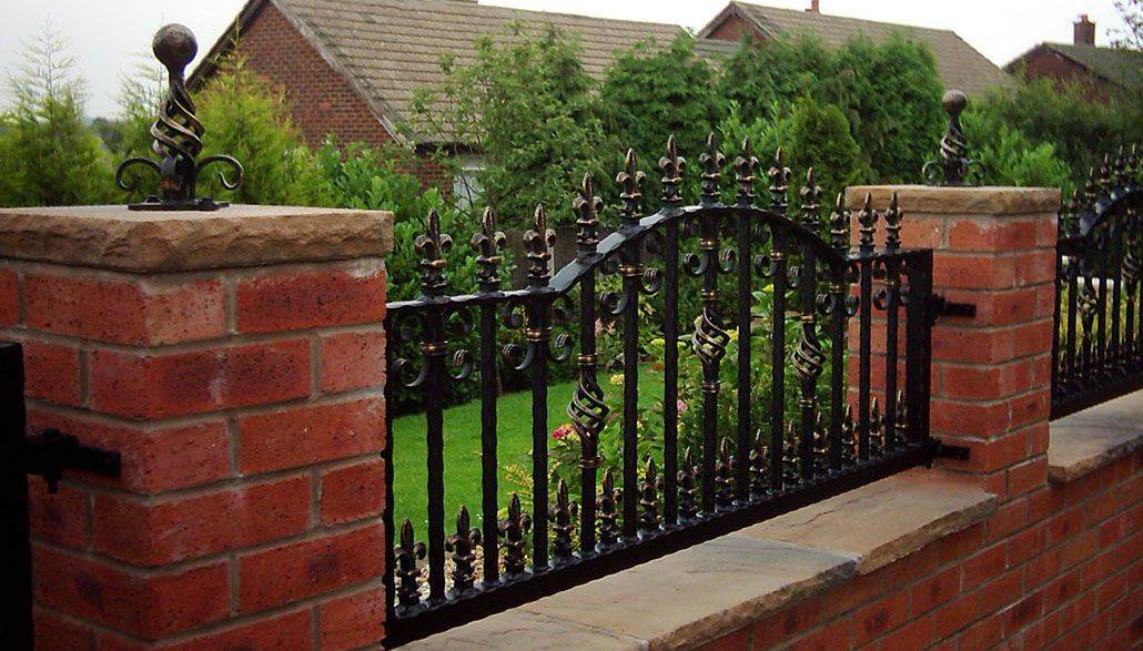 Sturdy wrought iron fencing and brickwork