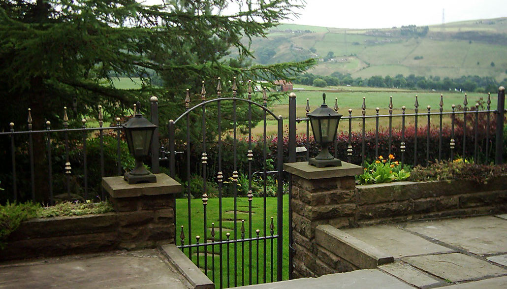 Wrought iron walltop railing and single gate