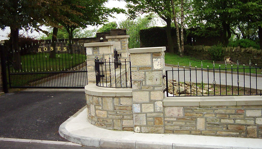 Wrought iron drive gate and radius panel