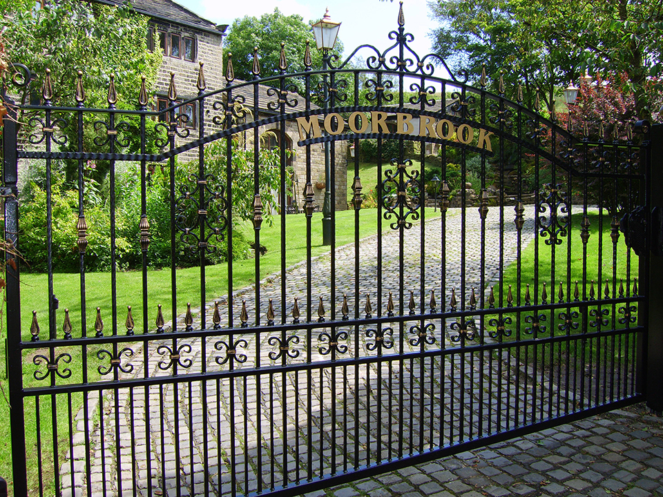 Automated wrought iron drive gate